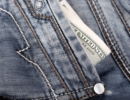 jeans pocket: Close up view on the old jeans pocket with money in it