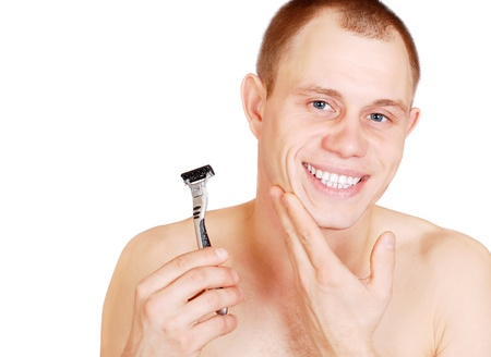 Satisfied young man with a clean-shaving face on white background photo