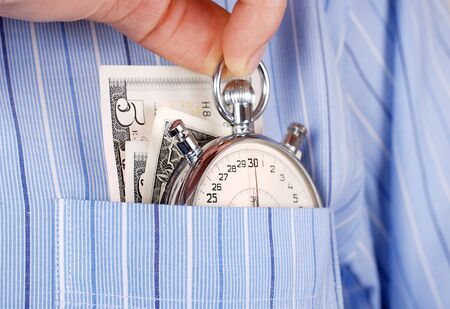 Close up view on stopwatch and banknotes into the pocket of shirt photo