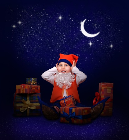 Funny little gnome with gift boxes at the last minutes to New Year midnight  photo