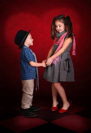 Little gentleman make a confession in love for his sweetheart lady photo