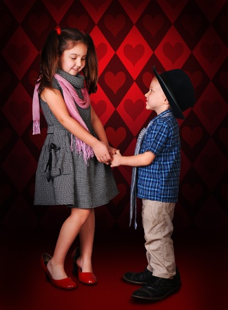 Little gentleman make a confession in love for his girlfreind photo