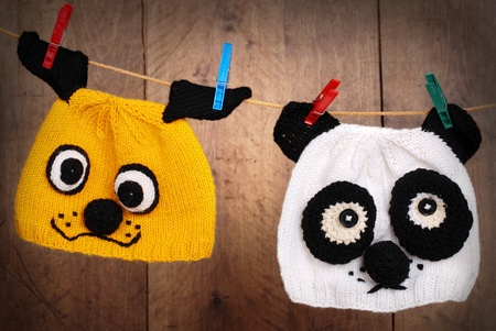 Two original design animal knitting caps on the linen rope photo