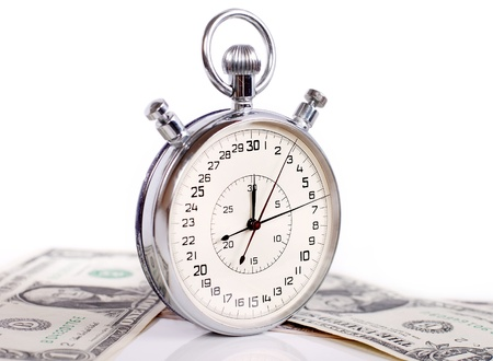 Two butons stopwatch with banknotes on white background photo