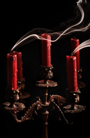 candelabrum: Blown candle with line of smoke in massive bronze candlestick
