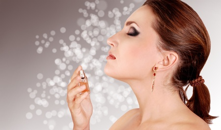 nose close up: Beautiful woman inhales with pleasure perfume aroma Stock Photo