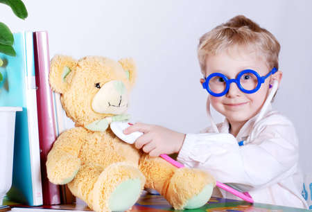 stethoscope boy: Little doctor  takes a patient - his teddy bear toy