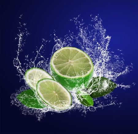 Abstract background with sliced lime in water drops photo