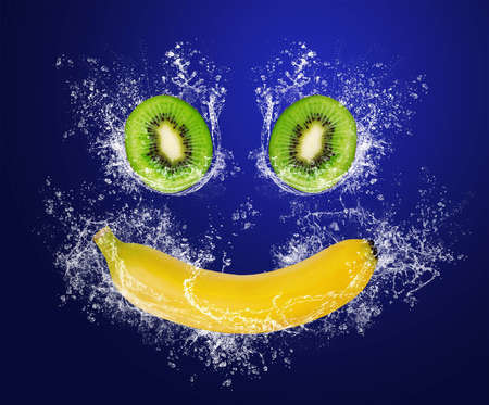 Abstract smile with tropical fruits in water splashes photo