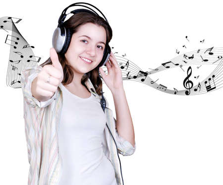 Happy Teenage girl in headphones on white background with music signs photo