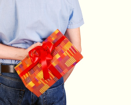 gift behind back: Gift box in man hand behind his back Stock Photo