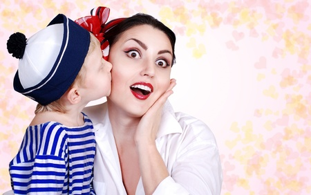 Son tender kissed his mother  Abstract background with hearts Stock Photo - 12852845
