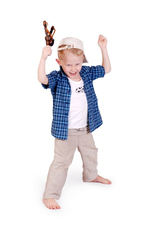 overindulgence: Victirious gesture from little madcap boy with sling shoot on white background
