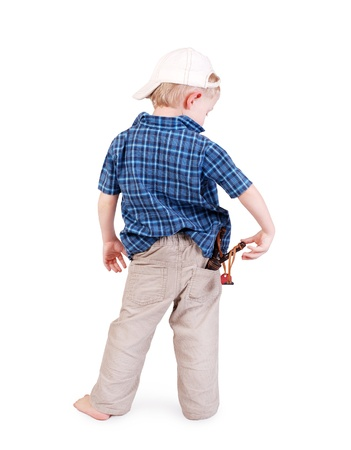 Back view on the little boy with a slingshot in his pocket photo