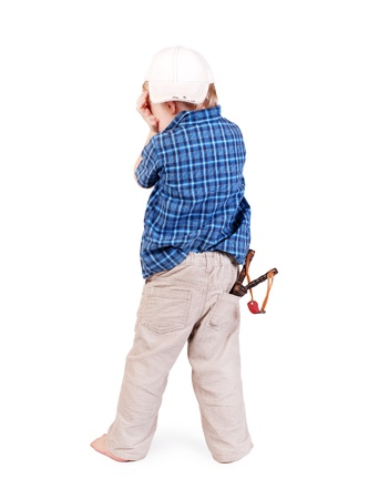 bad manners: Crying little boy in cap  with slingshot in his pocket over white background Stock Photo