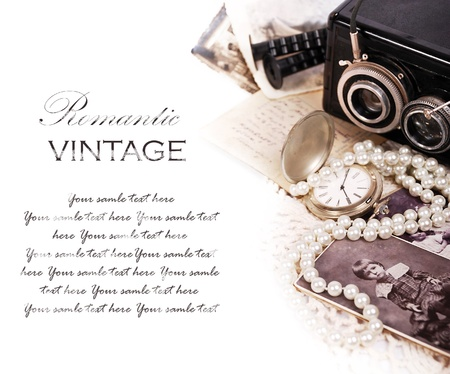 Background with vintage romantic photos, pearls, watch and letter photo
