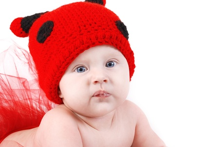 Cute baby in funny ladybug hat portrait Stock Photo - 13171002