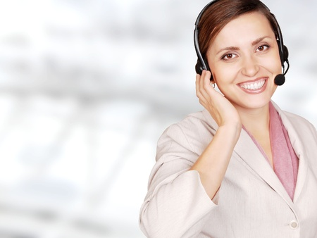 Attractive young woman call center operator over light gray background photo