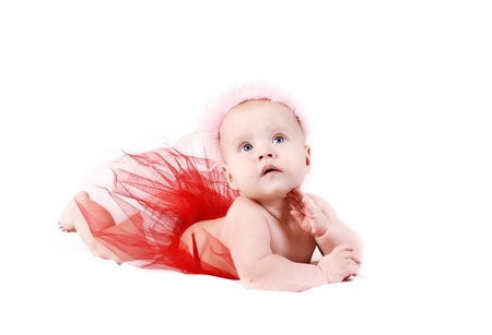 blue eyed: Lying pretty baby girl in red tutu and pink crown