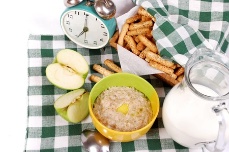 Closeup image ingridients for health breakfast - milk, oatmeal, baking and meal photo