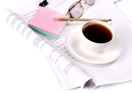 Closeup image with cup of coffee and business elements