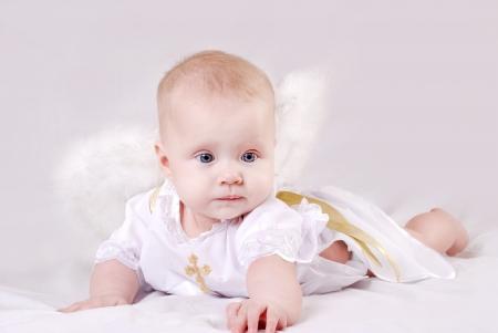 bautismo: Bastante pequeña niña con alas de ángel