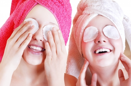 beauty care: Two Teenage girls cares about skin near the eyes