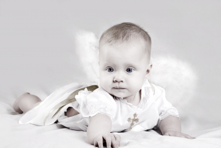 Pretty little baby girl with angel wings photo