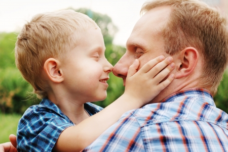 Heartwarming hugs little son and his father