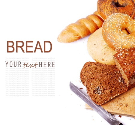 Different kinds of fresh bread over white background photo