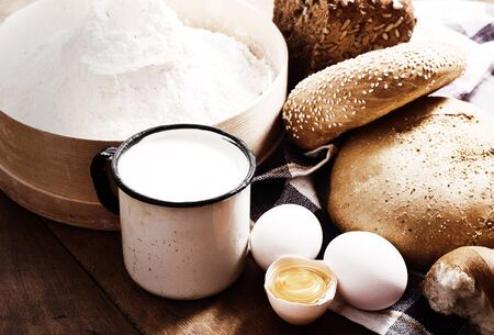 Fresh bread with ingredients for cooking in rustic style Stock Photo - 13864356