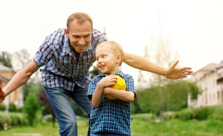 paternity: Father and son playing together at the park Stock Photo