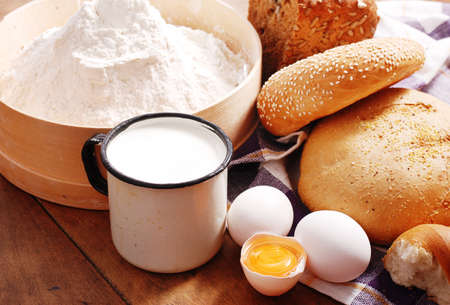 Fresh bread with ingredients for cooking in rustic style photo