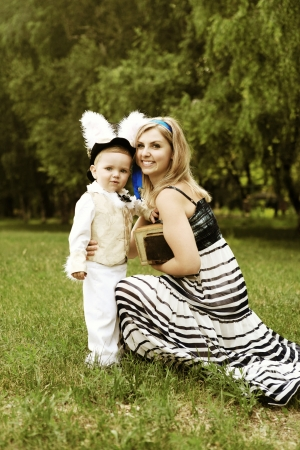 Happy young woman and little boy like characters of tale Alice in Wonderland