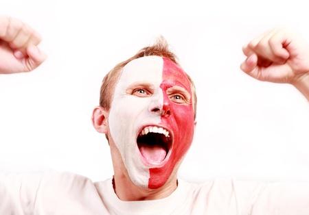 Emocional gritando fútbol Polonia ventilador con la cara pintada Foto de archivo