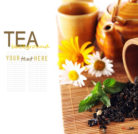 Tea theme background with daisy flowers and fresh mint photo