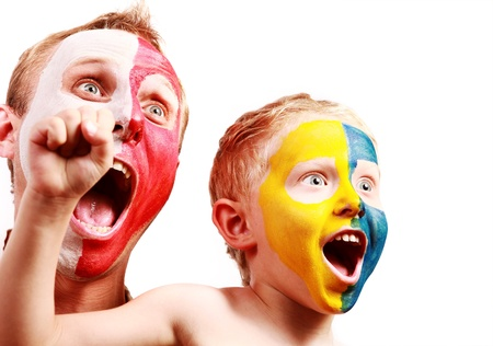 Two screaming fans - Poland Ukraine with painted faces in national colors photo