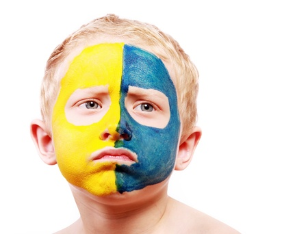 european championship: Portrait of disappointed little ukrainian fan with painted face