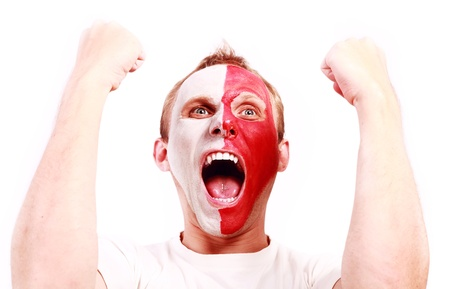 european expression face: Screaming football fan with face  painted in Poland color Stock Photo