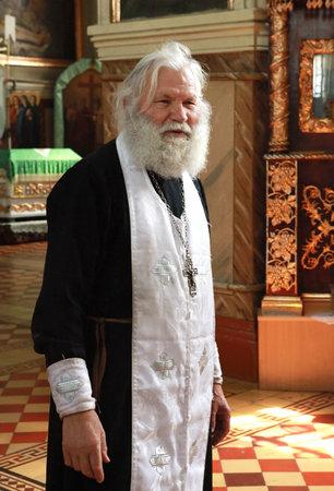 russian man: Orthodox abbe father Boris  into the Svyato-Porovskaya church in Ukraine; village Taromskoye