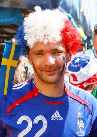 european championship: Ukraine, Kyiv, Khreshchatyk, 19.06.2012: fan zone, France football fan before start match Sweden France, Group D  Editorial