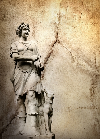 greek gods: Old stone background with a sculpture man with dog