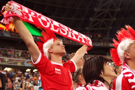 DONETSK, UKRAINE - 27 JUNE 2012: Football fans from Poland on the semifinal match Spain - Portugal. Donetsk, Donbass Arena. EURO 2012 in Ukraine, 27 june 2012