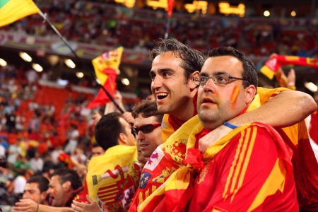 DONETSK, UKRAINE - 27 JUNE 2012: Spanish football fans support their national team on the semifinal match Spain - Portugal. Donetsk, Donbass Arena. EURO 2012 in Ukraine, 27 june 2012