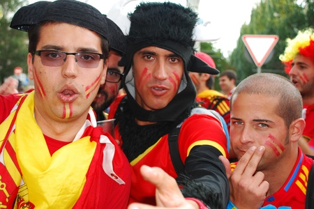 DONETSK, UKRAINE - 27 JUNE 2012: Spanish football fans in funny costumes before start semifinal match Spain - Portugal. Donetsk, Donbass Arena. EURO 2012 in Ukraine, 27 june 2012