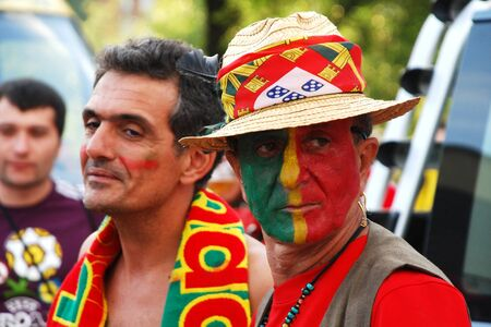 DONETSK, UKRAINE - 27 JUNE 2012: Groupe of Portuguese football fans before start semifinal match Spain - Portugal. Donetsk, Donbass Arena. EURO 2012 in Ukraine, 27 june 2012