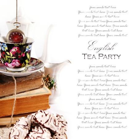 afternoon cafe: Ingl�s la fiesta del t� con el tema de fondo Wath bolsillo y los libros Foto de archivo