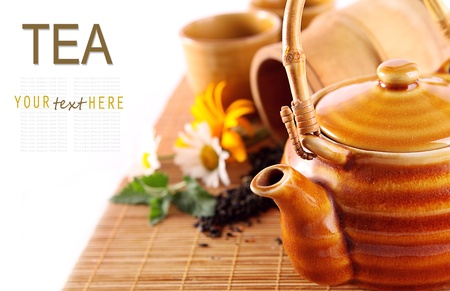 Background with chenese teapot on the bamboo cover Stock Photo - 14473405