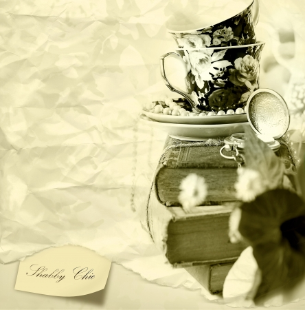porcelain flower: Romantic Shabby chic background with Old Books , pocket watch and cups Stock Photo