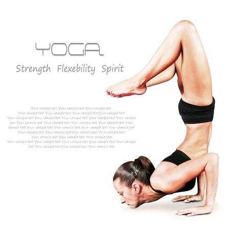 asana: Young woman doing yoga asana balancing on hand over white background